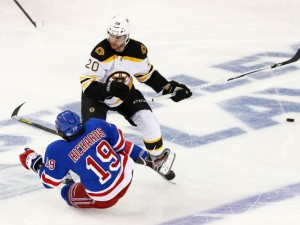 Brad Richards falls in front of Daniel Paille during the second period.